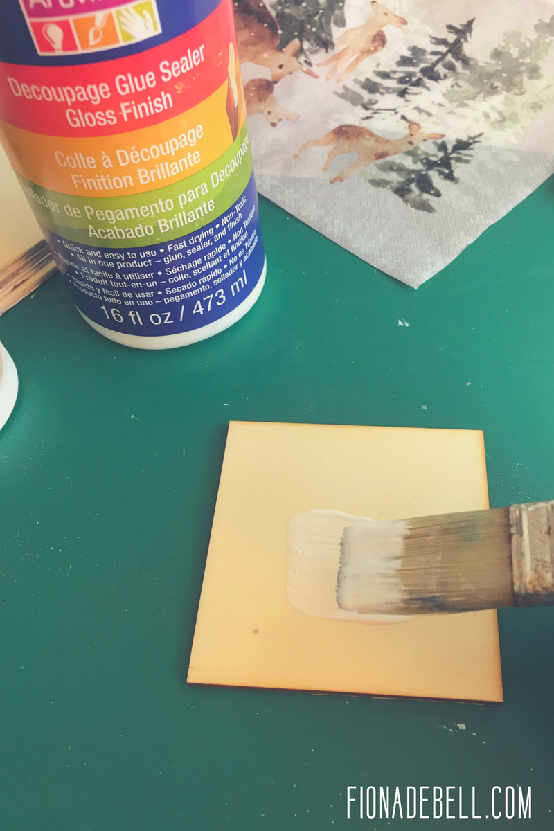 Applying decoupage gel to coasters. | fionadebell.com