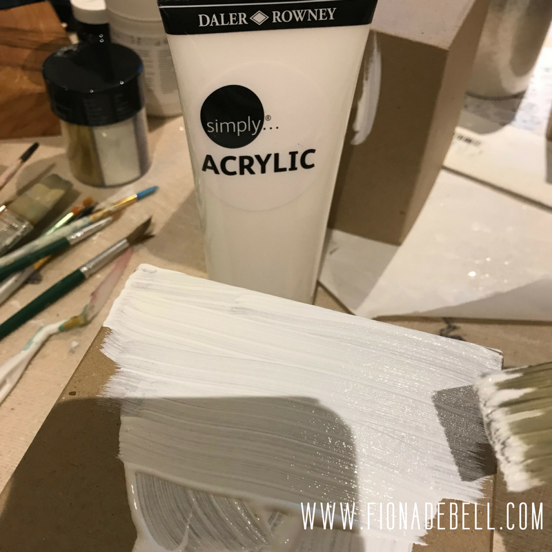 Painting a box with white acrylic paint.  |  fionadebell.com