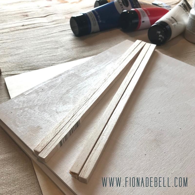 Cut Balsa Wood Sticks to create a picture frame. | fionadebell.com