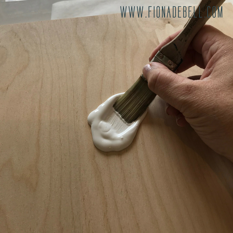 Painting a wooden board with white acrylic paint. | fionadebell.com