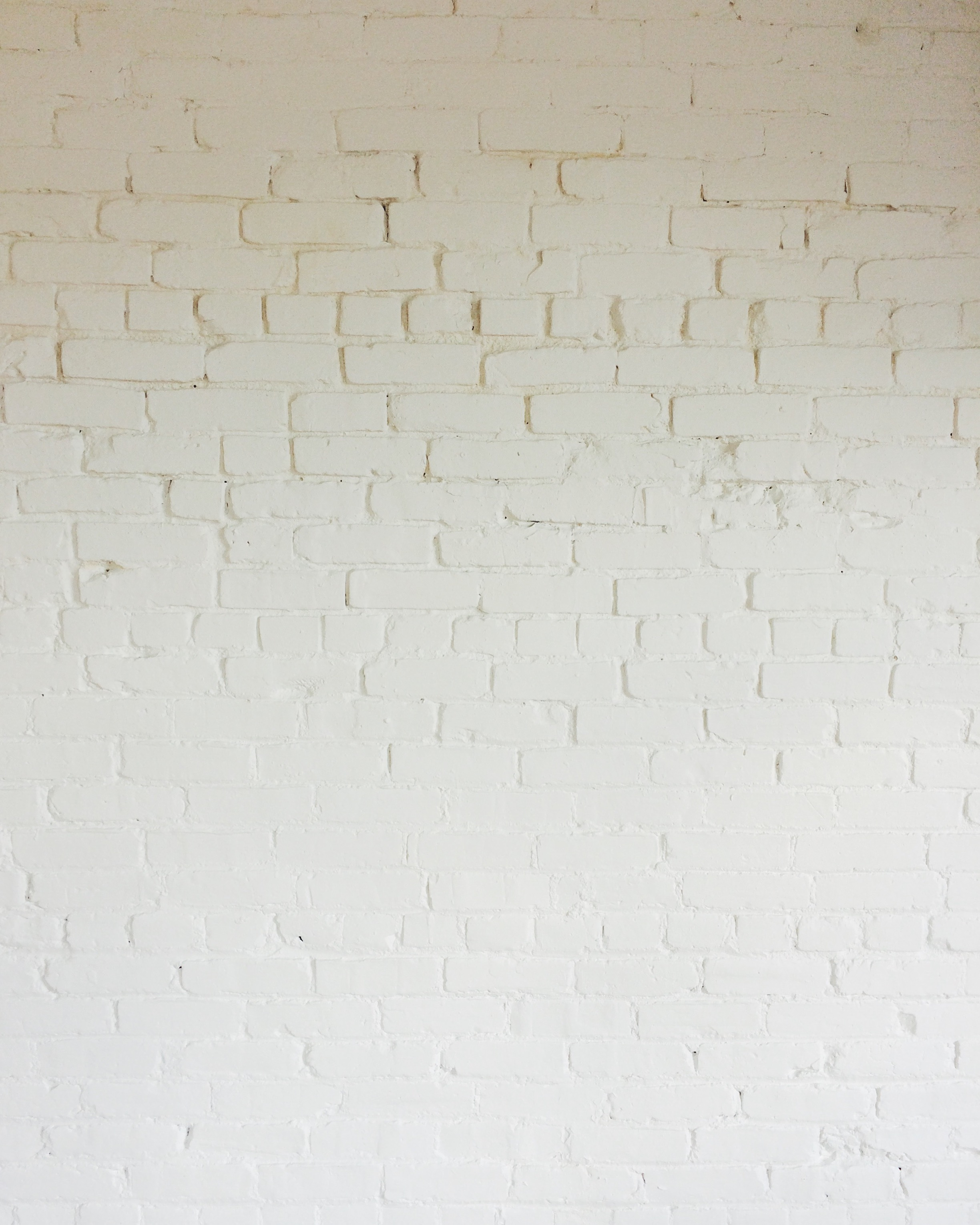 A simple palette of whitewashed brick defines the space.