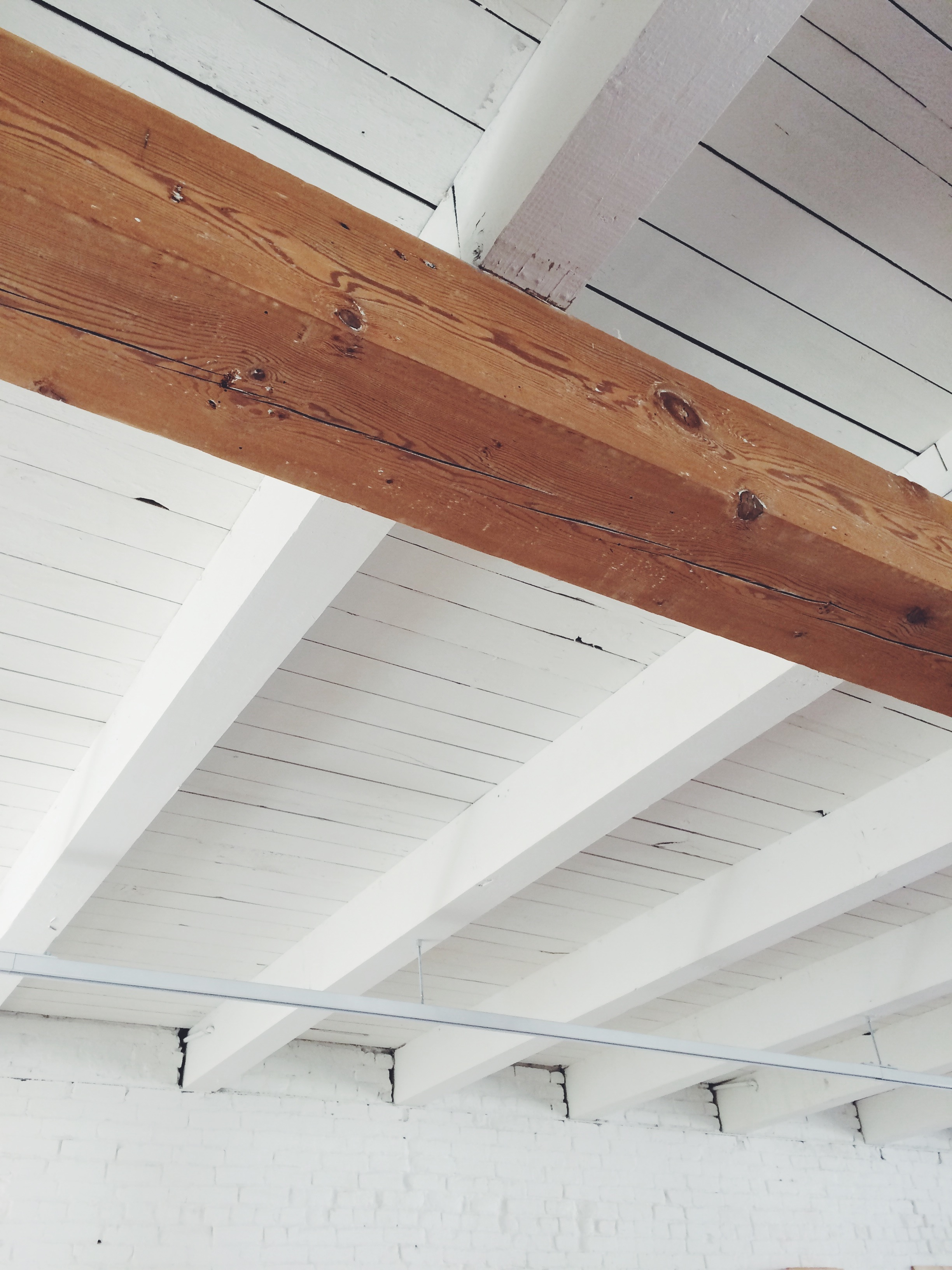 Existing columns and girders were restored to their natural color, while other structure was painted white.