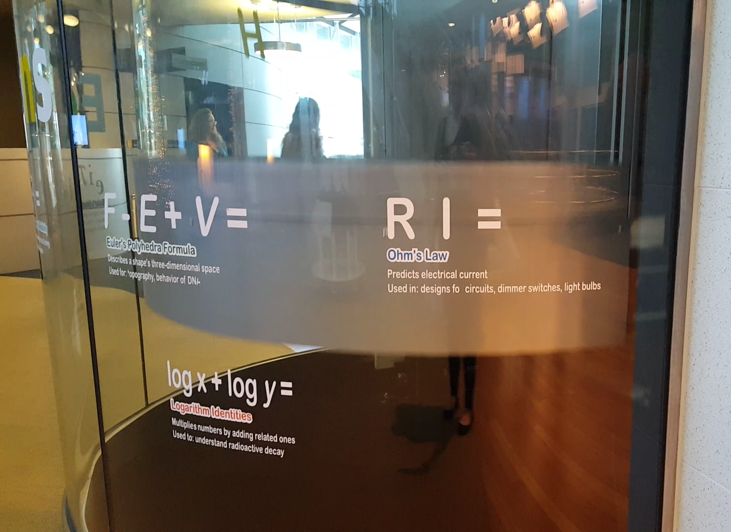 The round elevator is glass inside and out and the glass lines up the equations listed