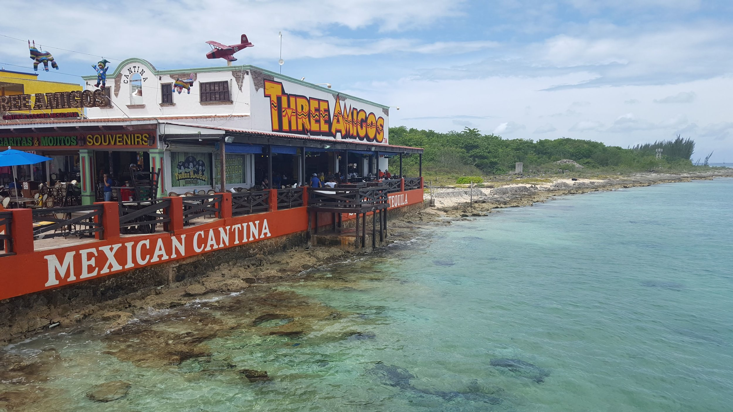 A popular tourist spot. Three Amigos is right on the edge of the pier when you get off of the boat and through Customs.