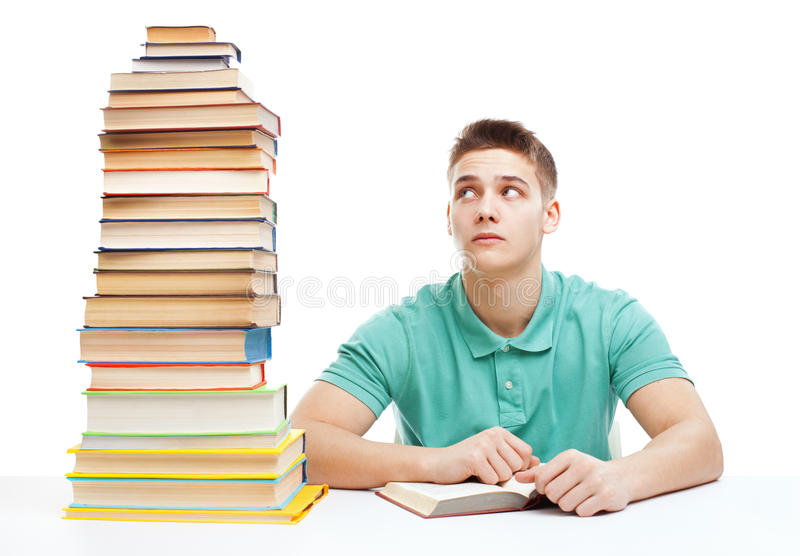 young-frustrated-student-sitting-desk-high-books-sta-stack-isolated-white-background-34742257.jpg