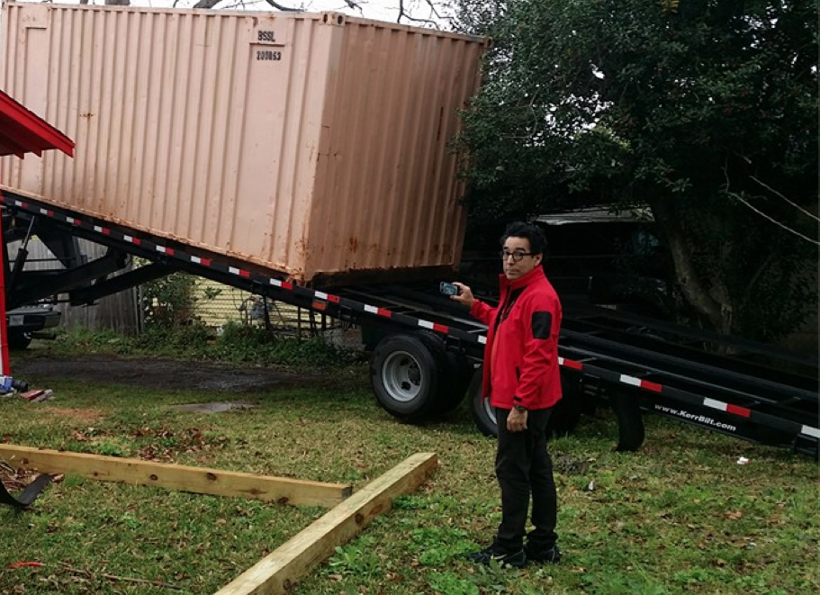 Observing the initial deposit of the shipment container in the backyard of the Sanchez Law Building.