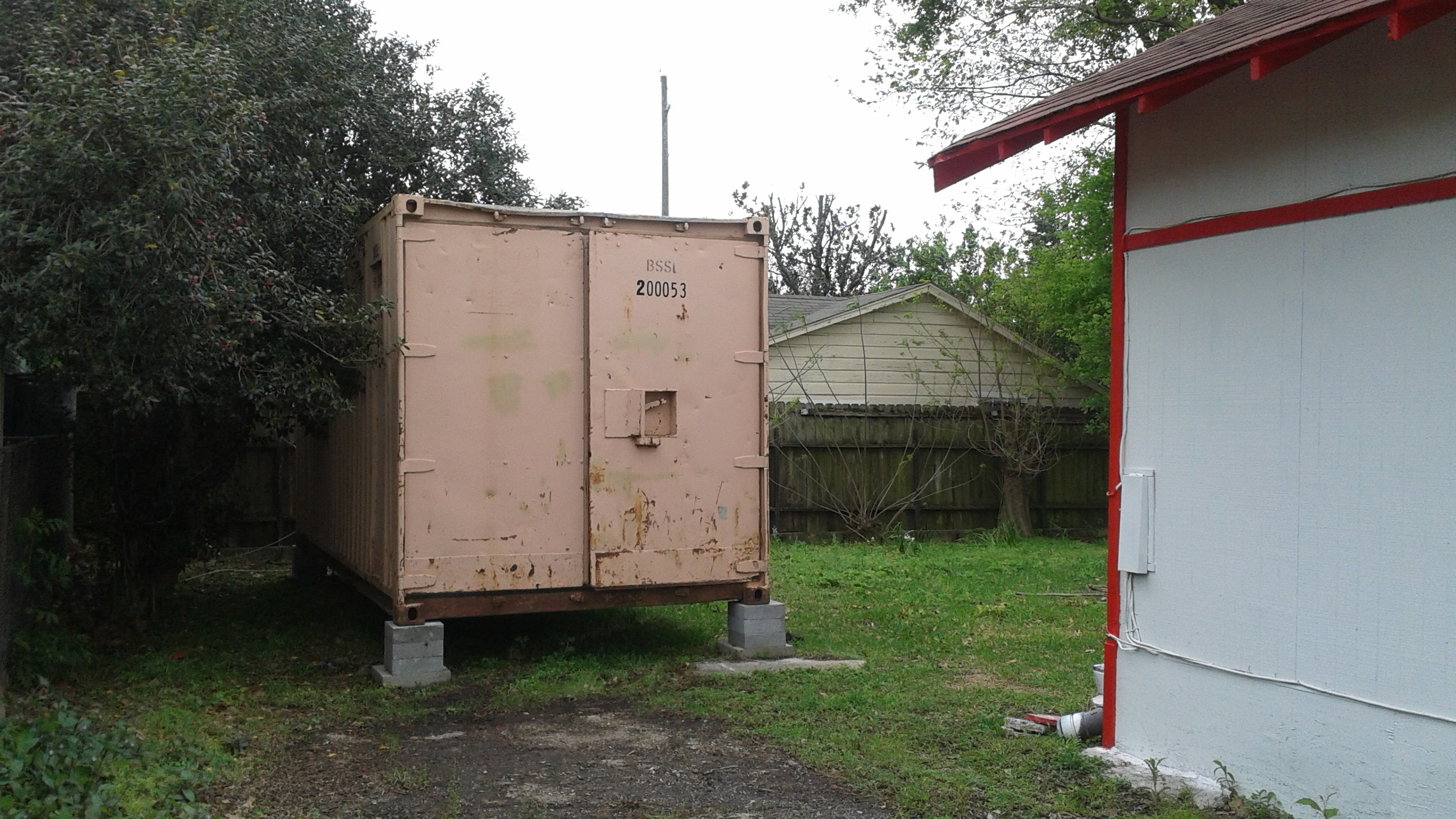 The ISBU container from the driveway of the Sanchez Law Building.
