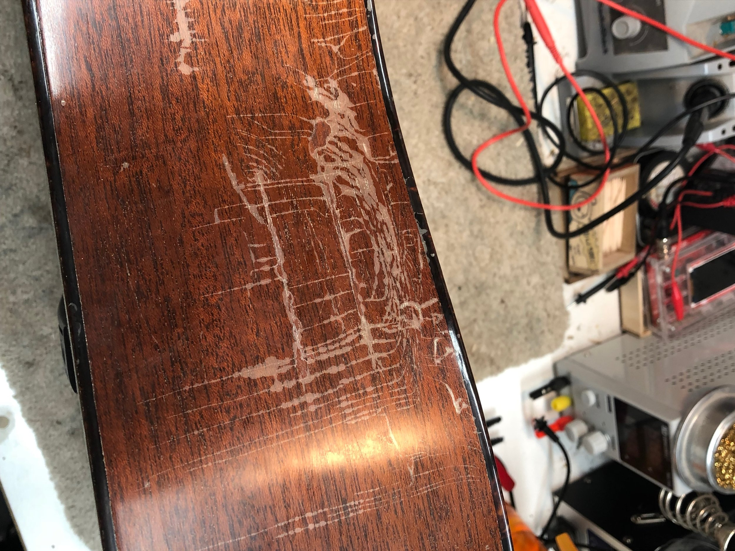 As you can see the rib was showing signs of the lacquer separating from the wood in the waist area of the rib. Using a lacquer retarder base solution the finish melts pretty nicely back into itself making the hazing much less noticeable and helping it not to chip off.