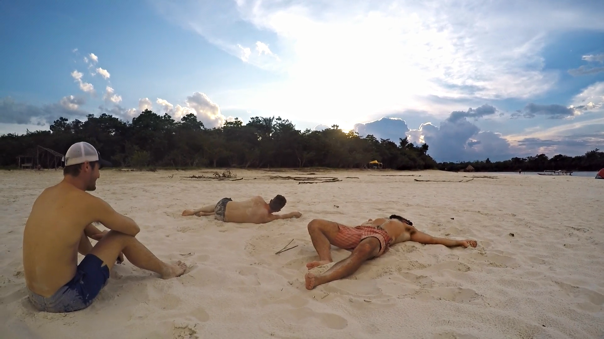 Rich looking on, as Jonathan and Peter's bodies melt into the sand, their minds dissolving into the cosmos.