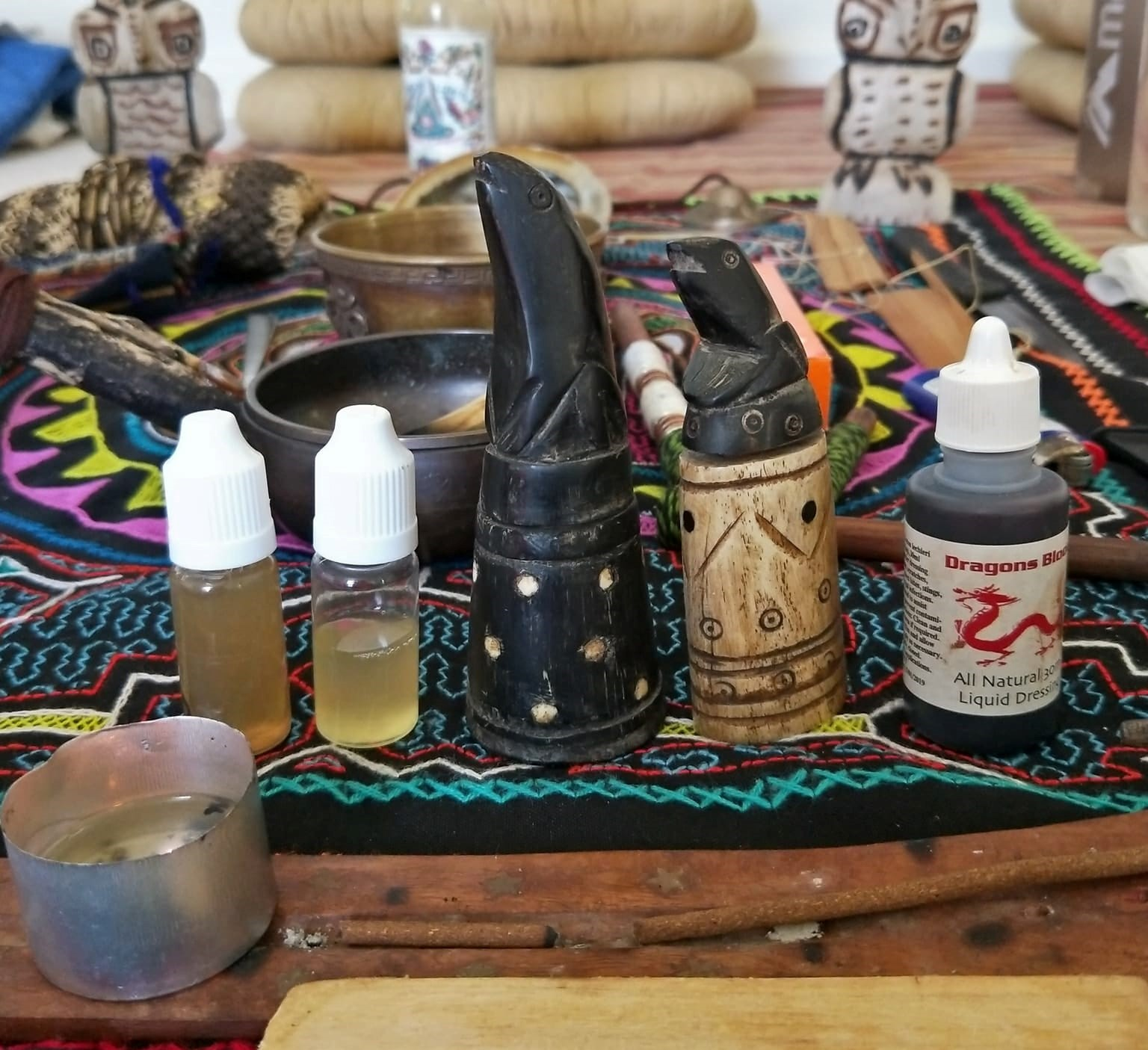Sananga eye drops pictured in the two bottles to the left. The darker liquid diluted with colloidal silver - to act as preservative, and to decrease the strength of the already strong medicine.