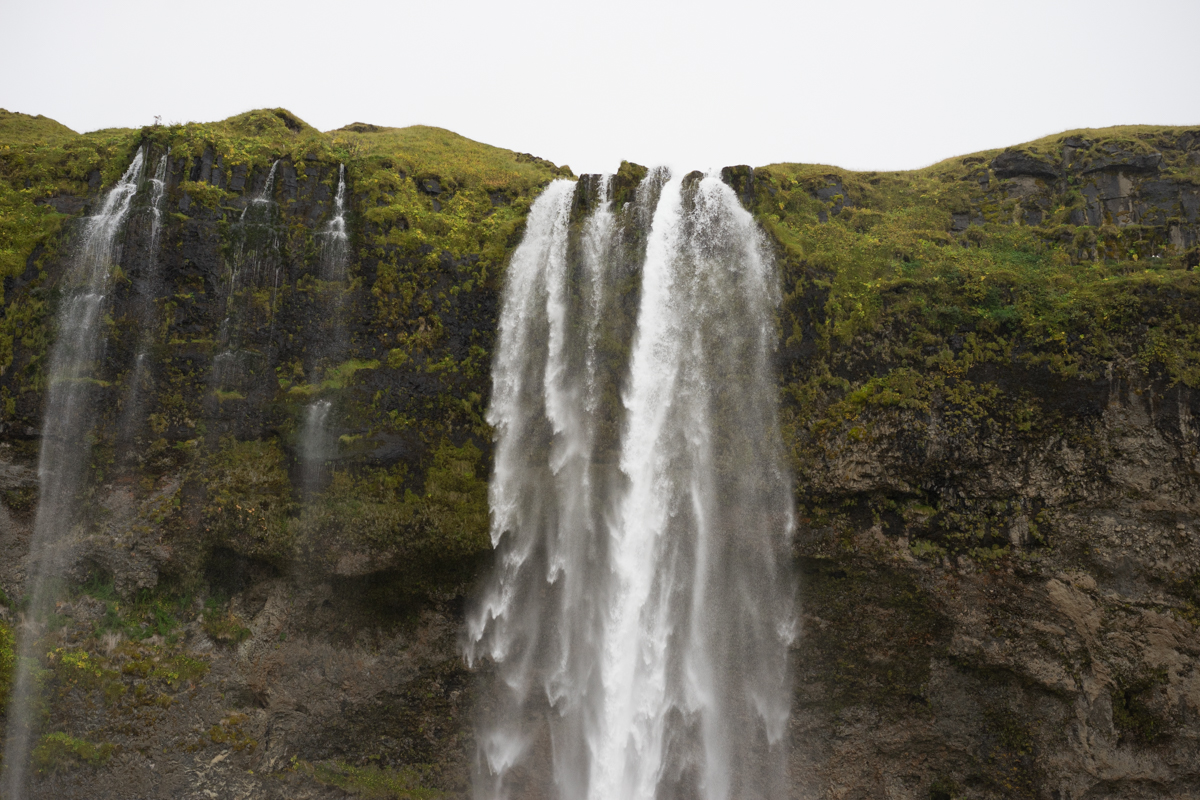 The famous Seljalandsfoss Waterfall... it started raining again once we arrived.