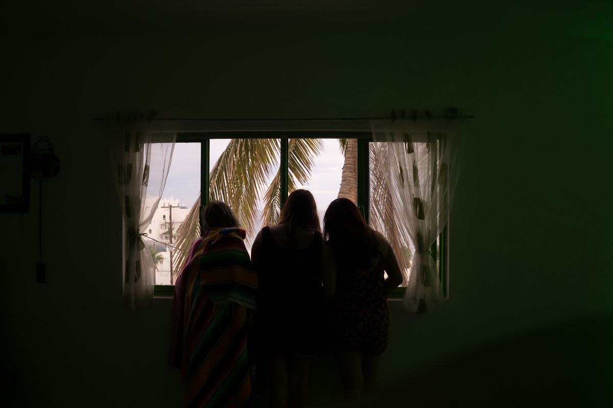 Claudia, Sara, and I gazing out the window at the beach across the street from the hostel in Cabo San Jose.