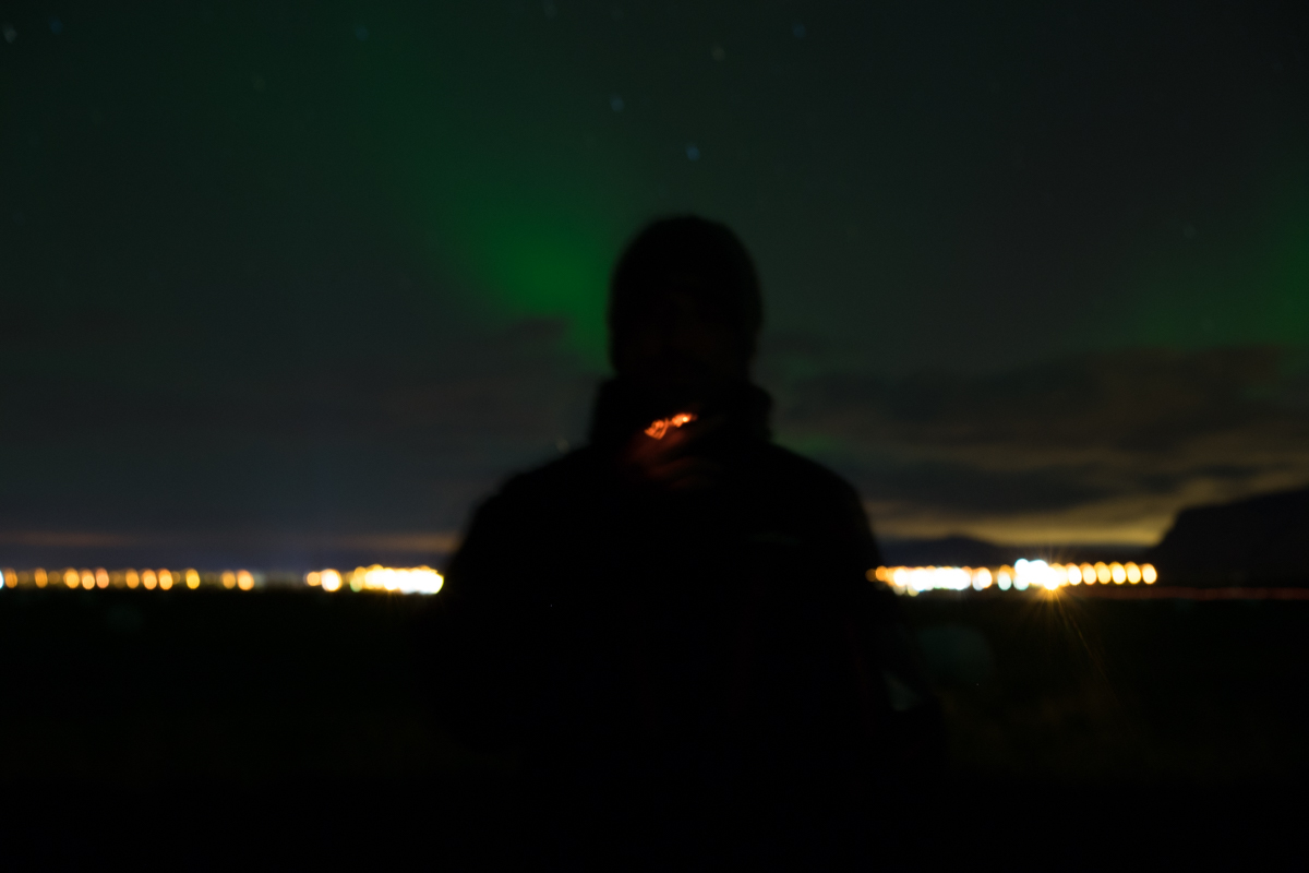The aurora borealis turns cigarette smoke green... just kidding.