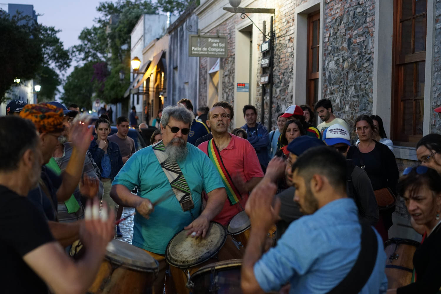 The crowds begin to follow the Colonia Drum Line as the sun sets.