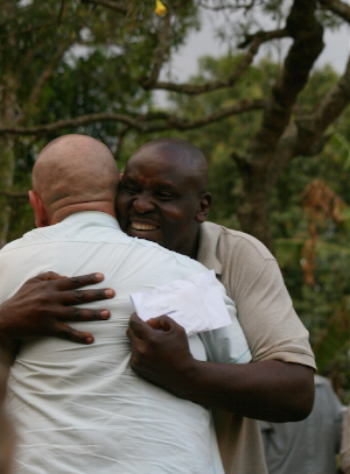 big hugs from the community leader after gifts of soap, sugar and salt