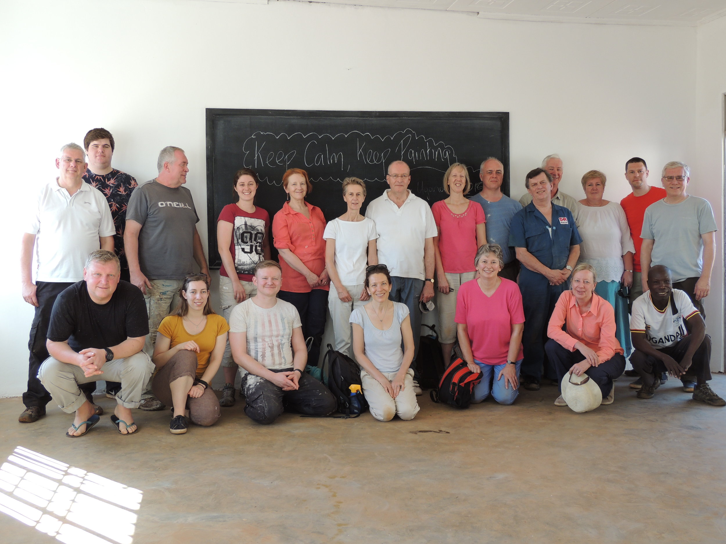 The Ugandaid Team - Just before the final coat of gloss in the mechanics class room at NVI.