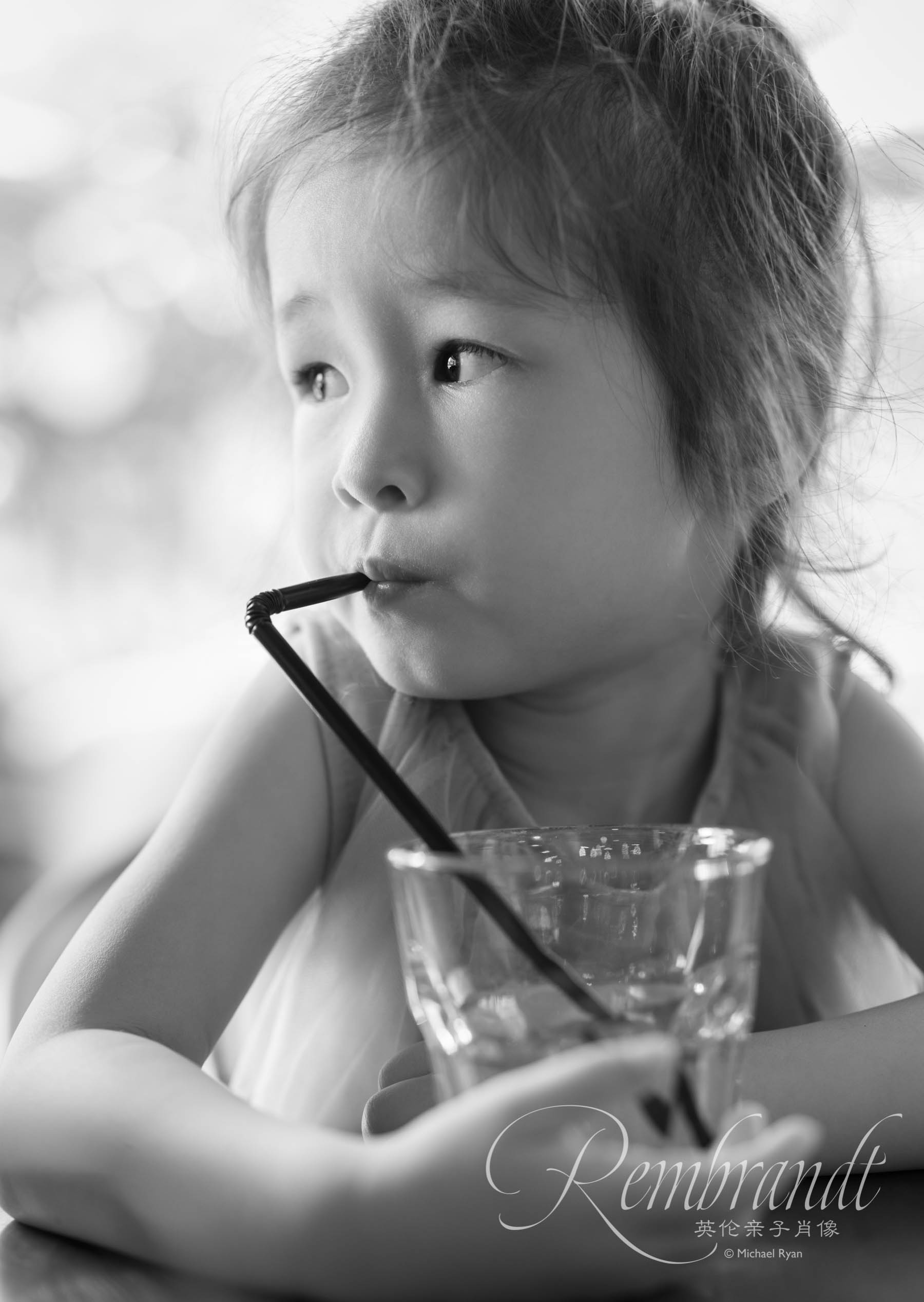 This could have been shot almost anywhere (but probably a Wagas judging by the glass) at any time and it definitely doesn't count as one of the great moments of her life. But I love her idleness dreaming of who knows what while enjoying the childish thrill of drinking through a straw.