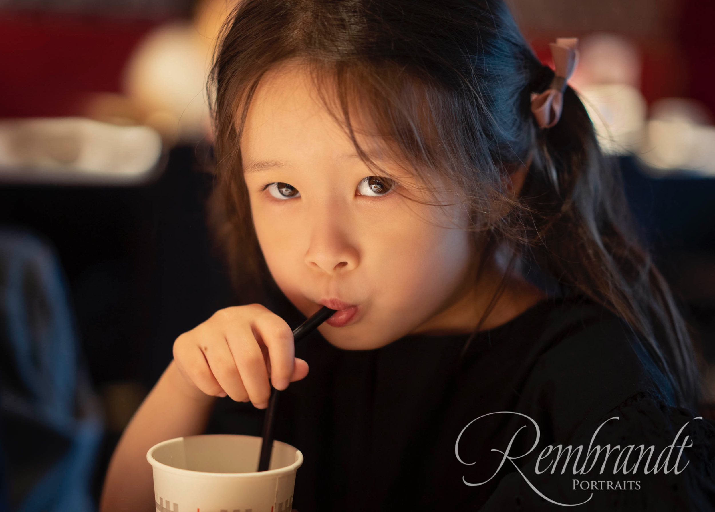 My middle daughter was being as cute as ever in this restaurant and I took five adorable photos of her drinking through a straw. But after some consideration (and it was tough) I choose just this one.