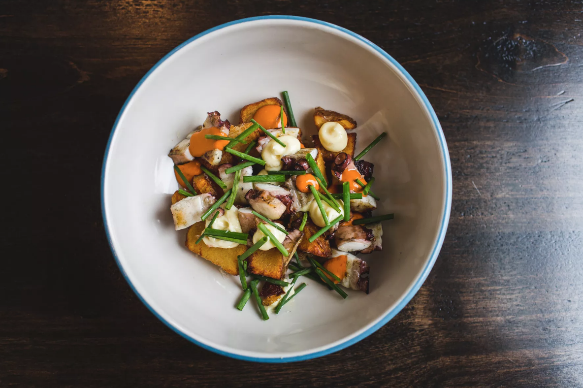 hot dish: the saucy Octopus patatas bravas at annette (eater)