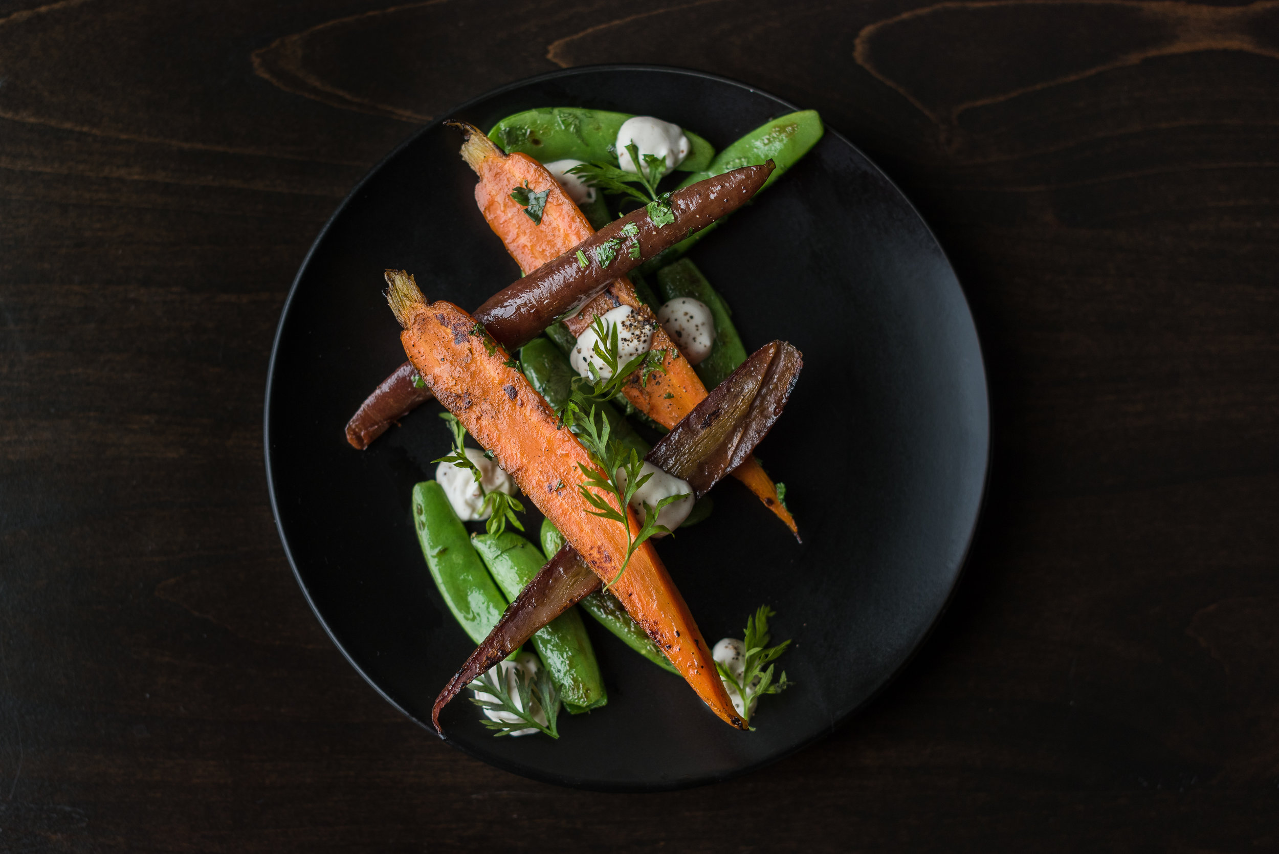 Grilled carrots and peas with cilantro, charred orange and spiced cream