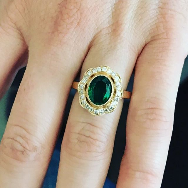 Bezel set rich green natural emerald with an antique diamond halo  #maybirthstone #diamondconsultants