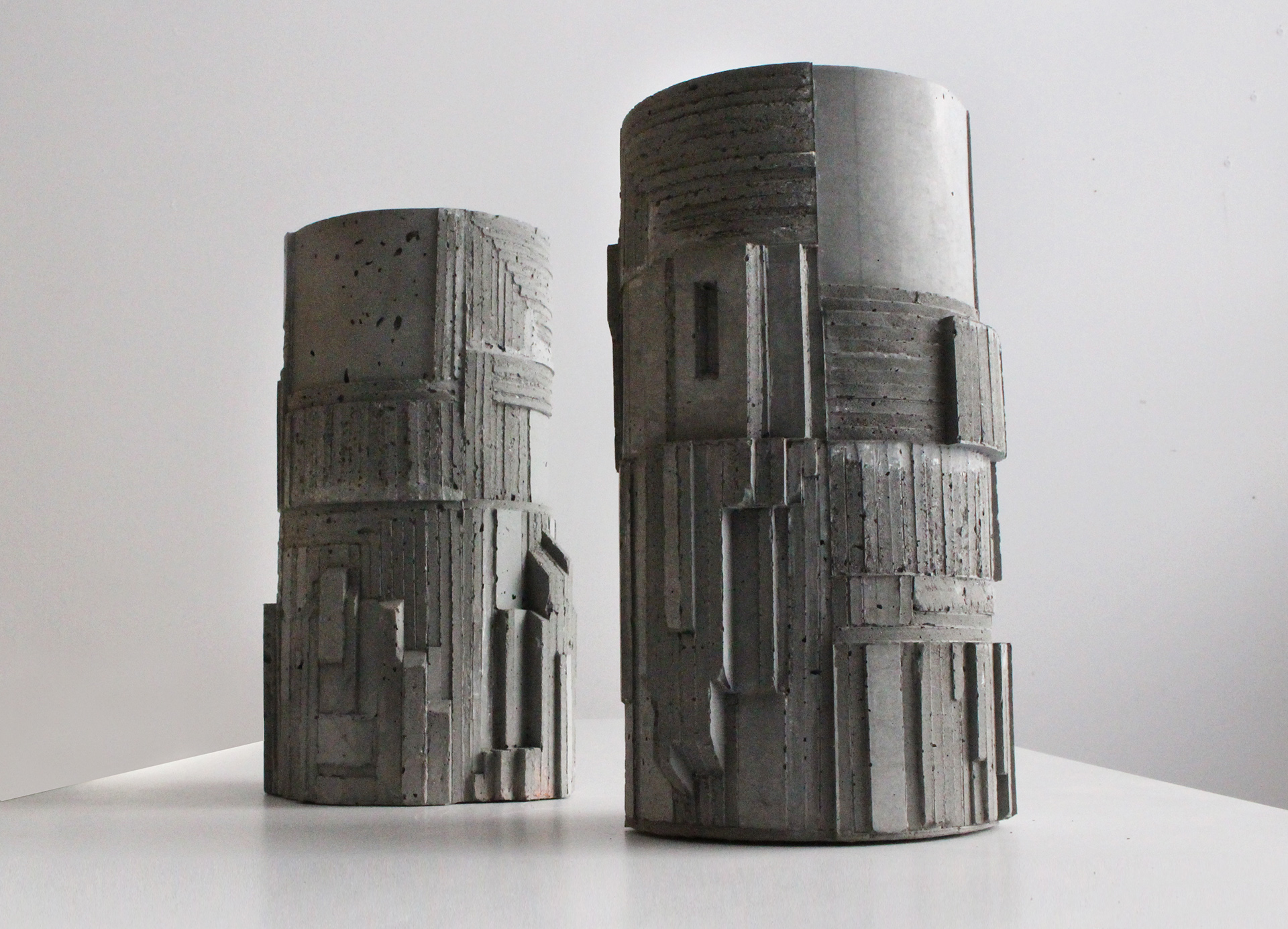 """Brutalist Concrete Vase No.1- by David Umemoto. Observe the detailed molding and delicate forms on the vases- which are only 12"""" high."""