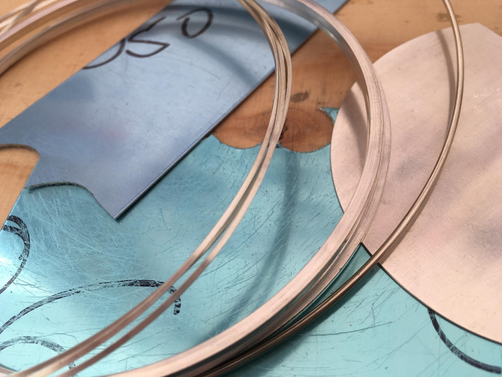 Sheet metal and wire, before being crafted into jewellery by Megan Collins Jewellery