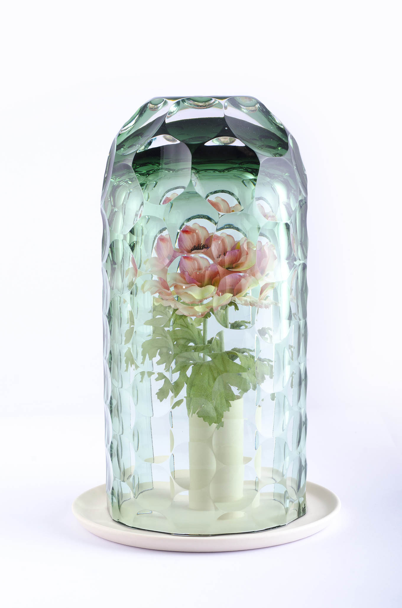 OP-Vase  by Bilge Nur Saltik, creates a kaleidoscopic effect with its unique technique of cutting glass, a timeless material.