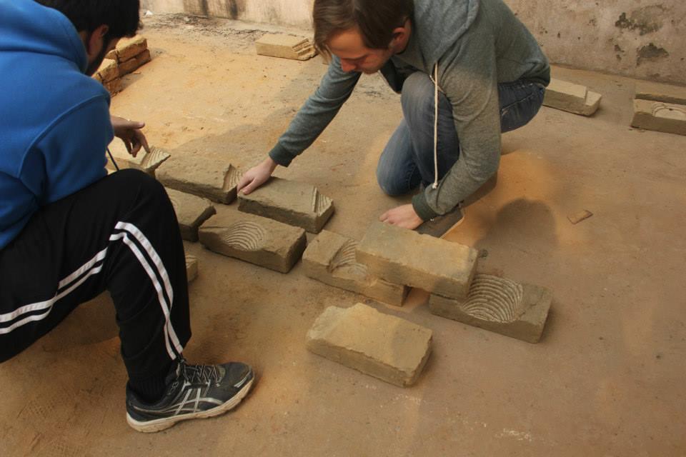 makeLab™''s students create a mockup of a wall, using digitally-milled bricks.