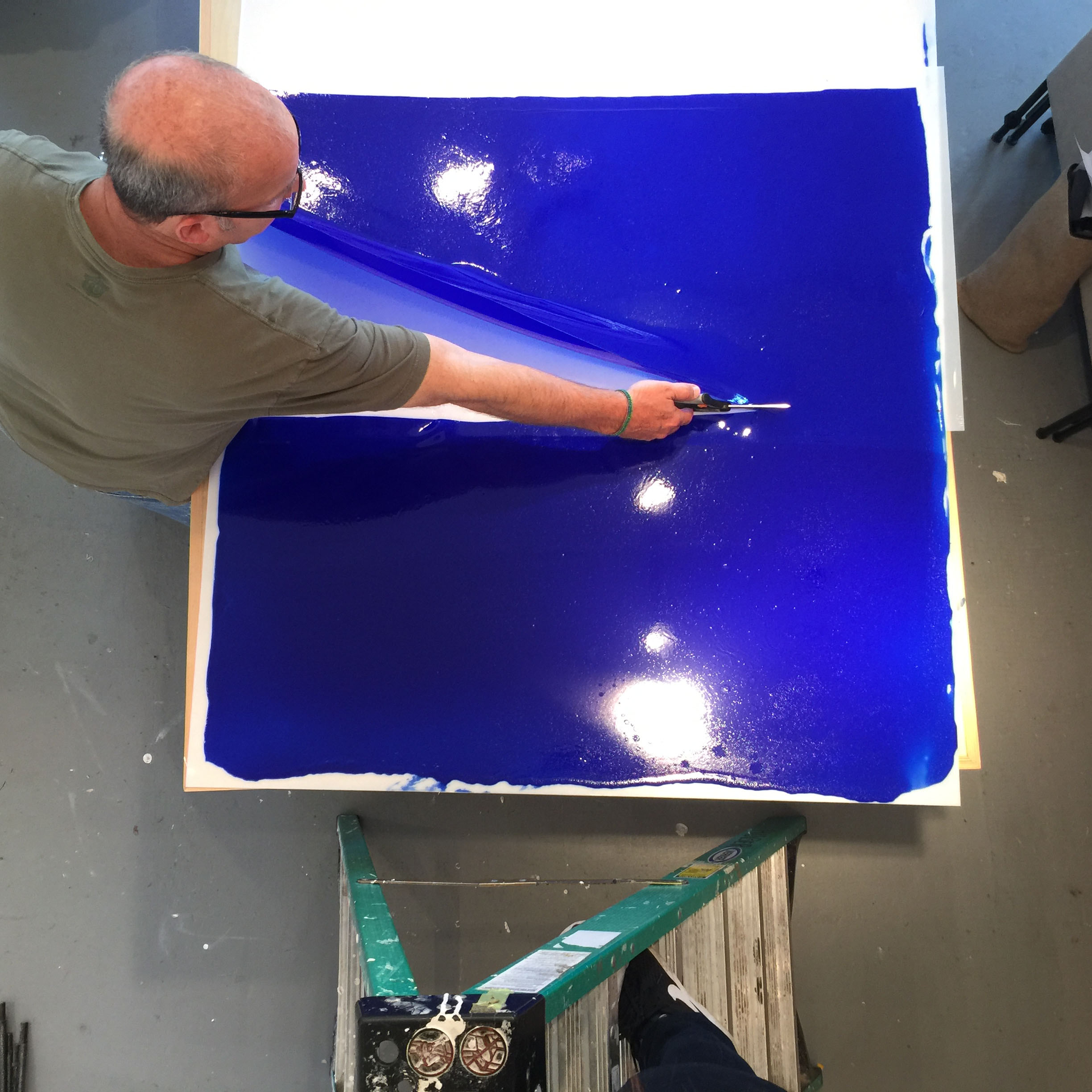 Artist Brian Huber dries Acrylic gels to a pliable sheet-like form, cut into strips in his artwork.