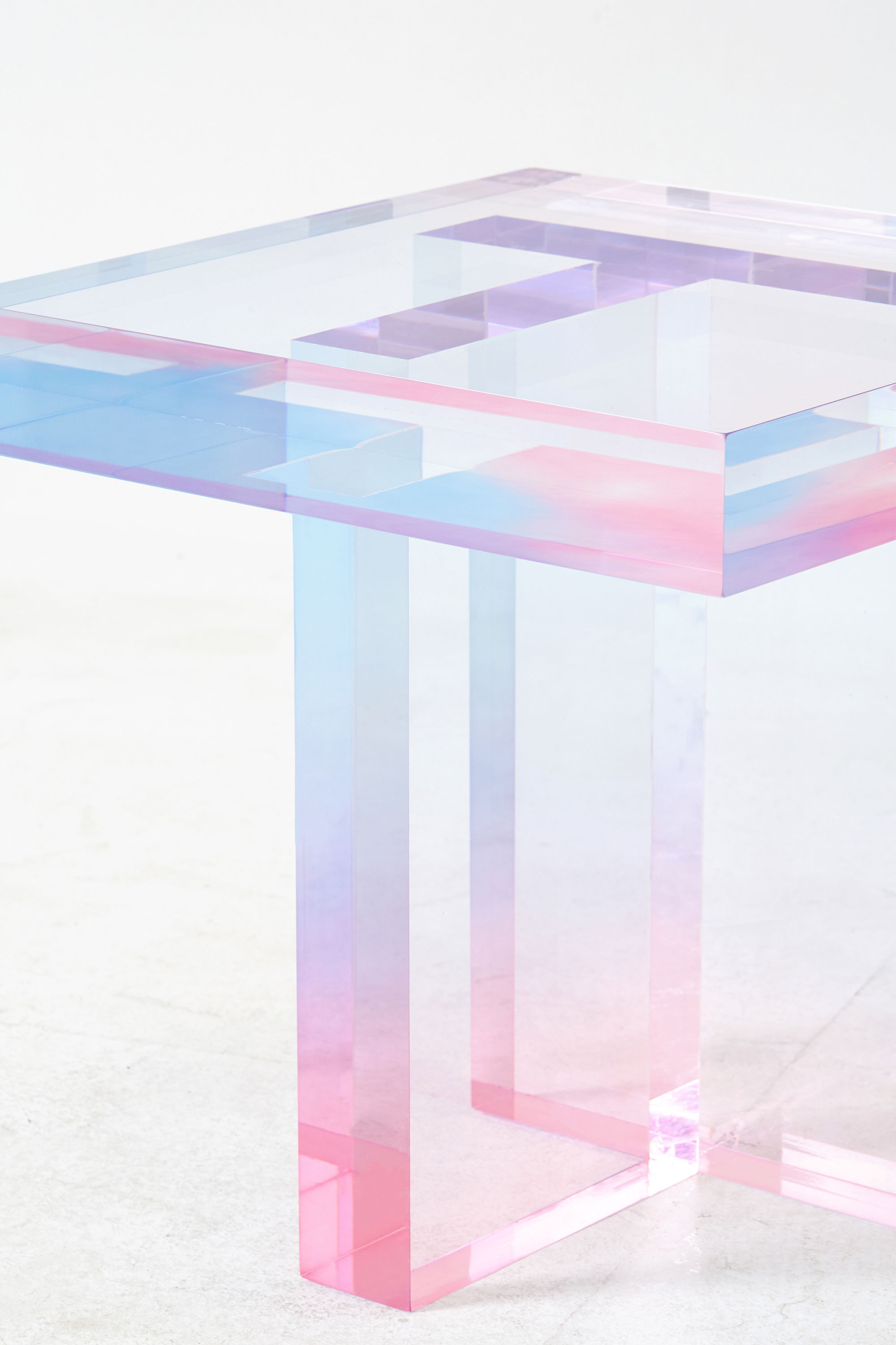 Intersections, junctions and optical interactions between colors and layers of the acrylic resin, created by Saerom in the  Crystal Series  of tables.