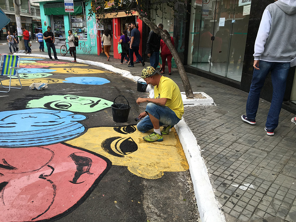 Gypsum-based paint transforms the high-traffic intersection into a pedestrian-oriented plaza.