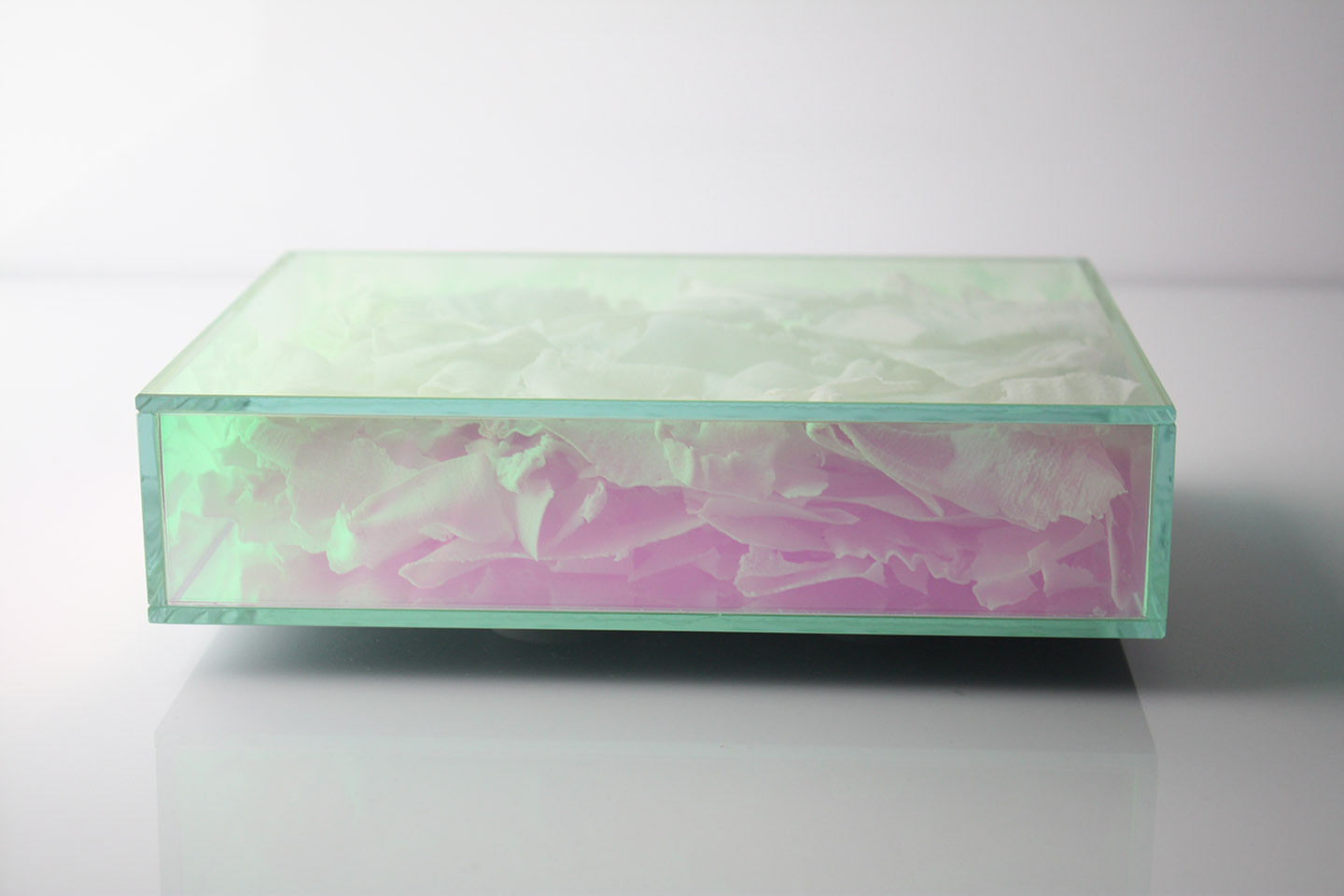 Manos Kalamenios and Fenella Osborne  create the union of two unlike materials–Dichroic Glass and Porcelain flakes.