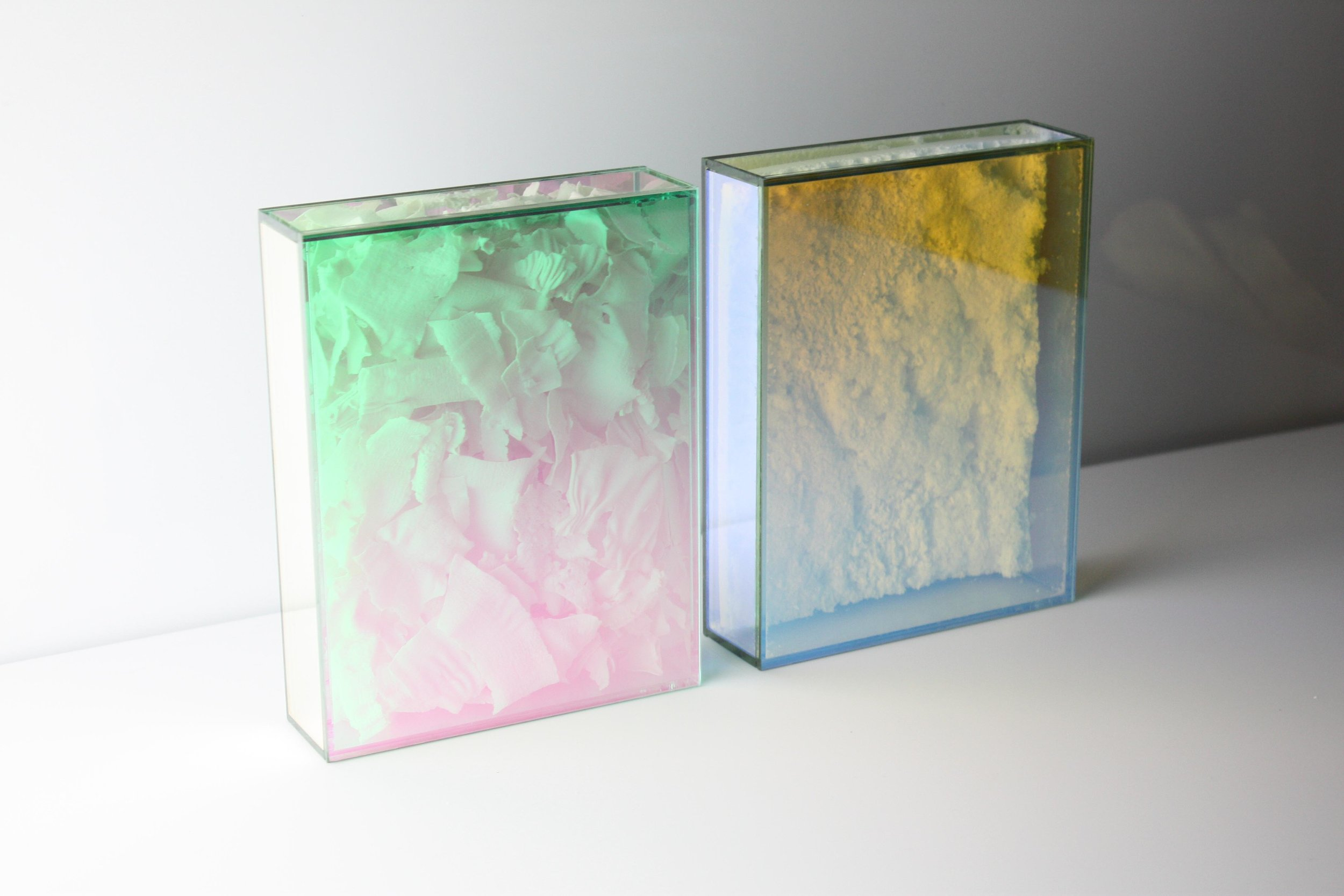 Manos Kalamenios and Fenella Osborne  create the union of two unlike materials–Dichroic Glass and Porcelain flakes and Bone-China Foam.