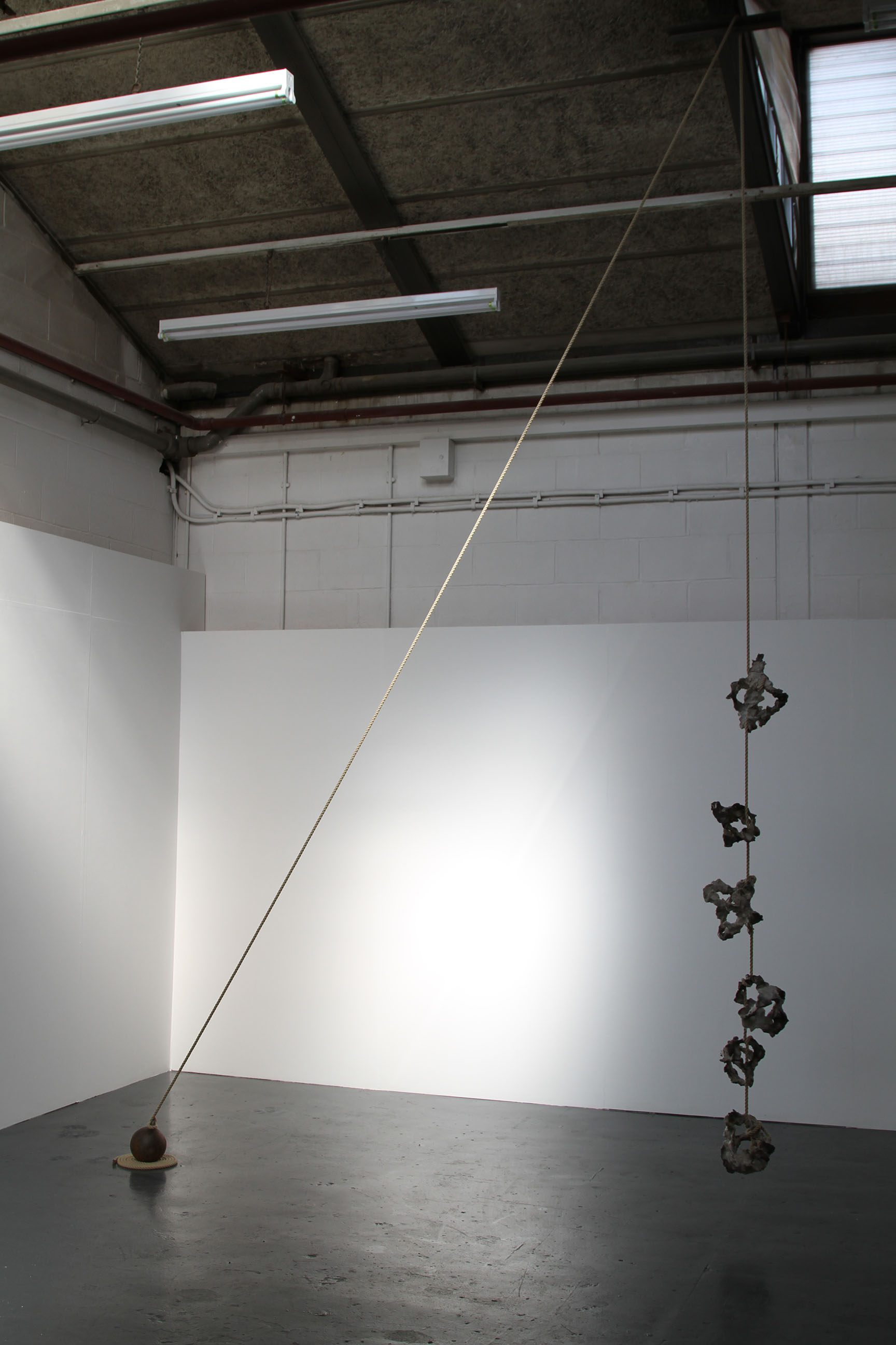 Playing a performative role, and creating a temporal experience, Javier Torras' BalancedTension,  2016, 490x300x15cm, Iron,steel,clay,wax and rope.