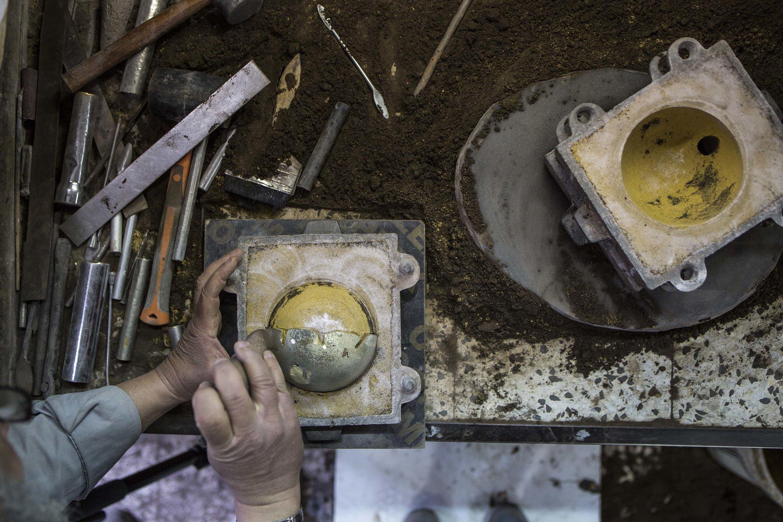 Dual Bowls  by Kawther Al Saffar, being cast by craftsmen at the Alwafi Foundry