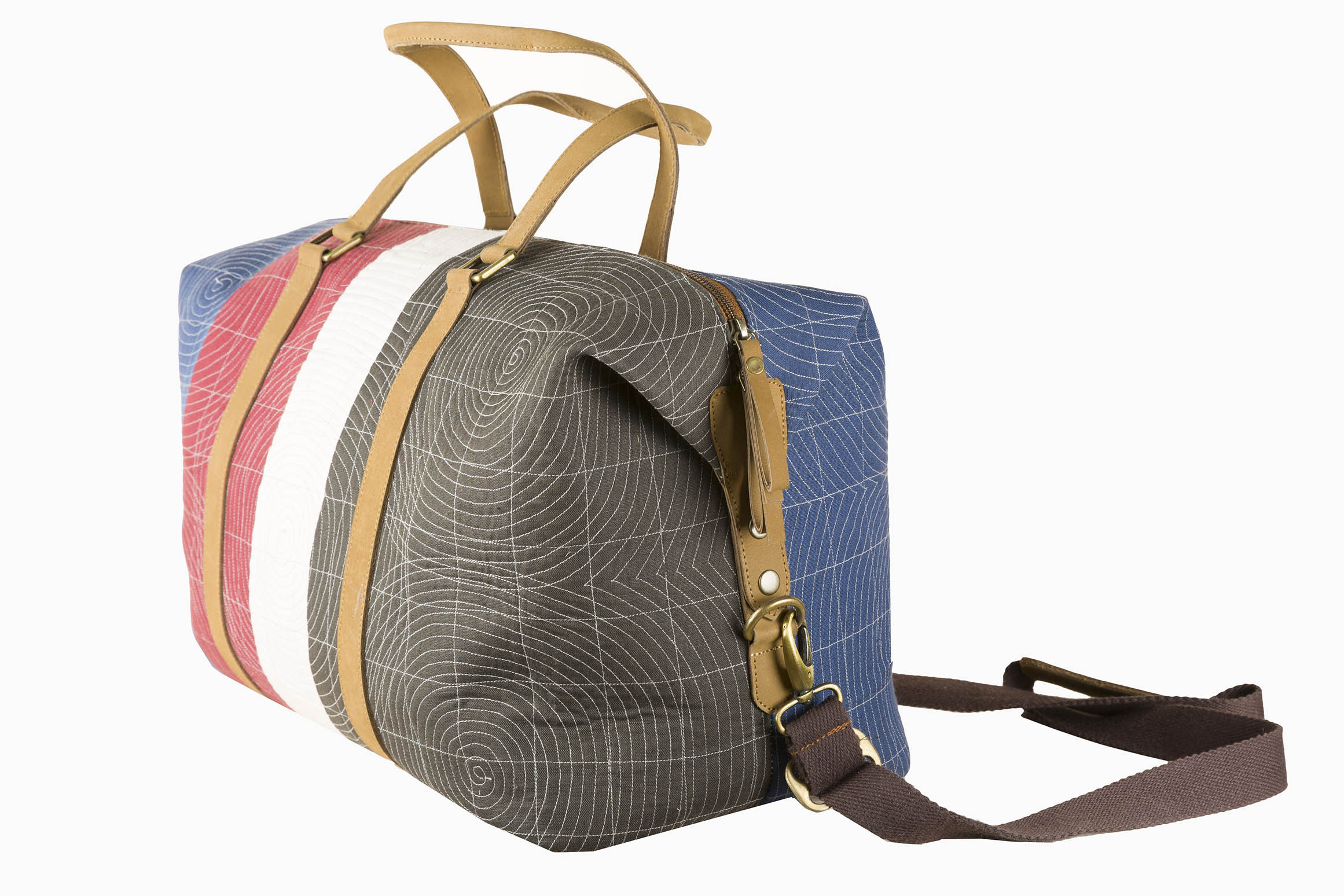 Disparate fabric pieces are quilted together to create robust and elegant pieces like this–A large bag from  Doodlage's  new accessories collection.