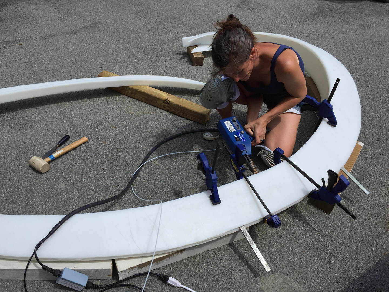 Aurora works on welding industrial plastic debris, for outdoor sculptures and installations