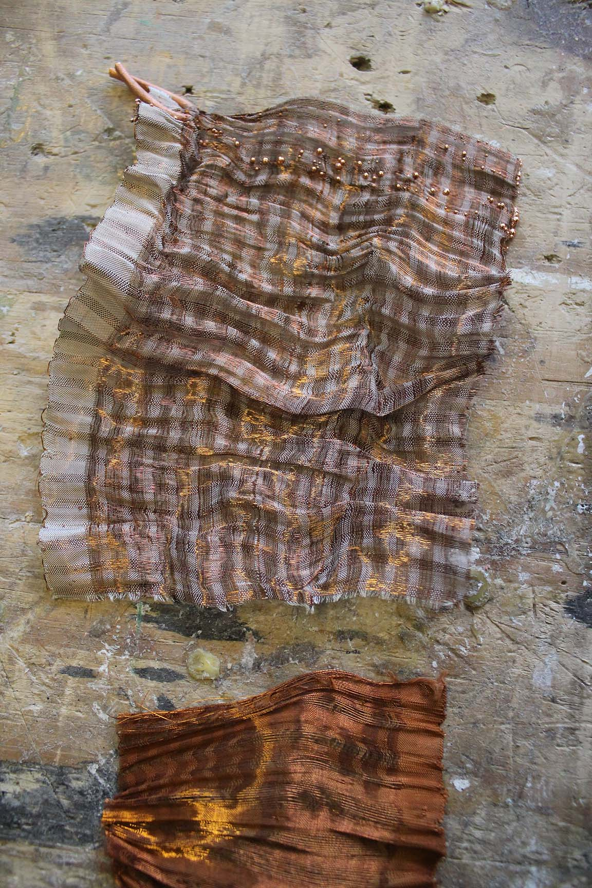 Woven, patinated textiles created from Copper Wire and Paper Yarn, by Neha Lad