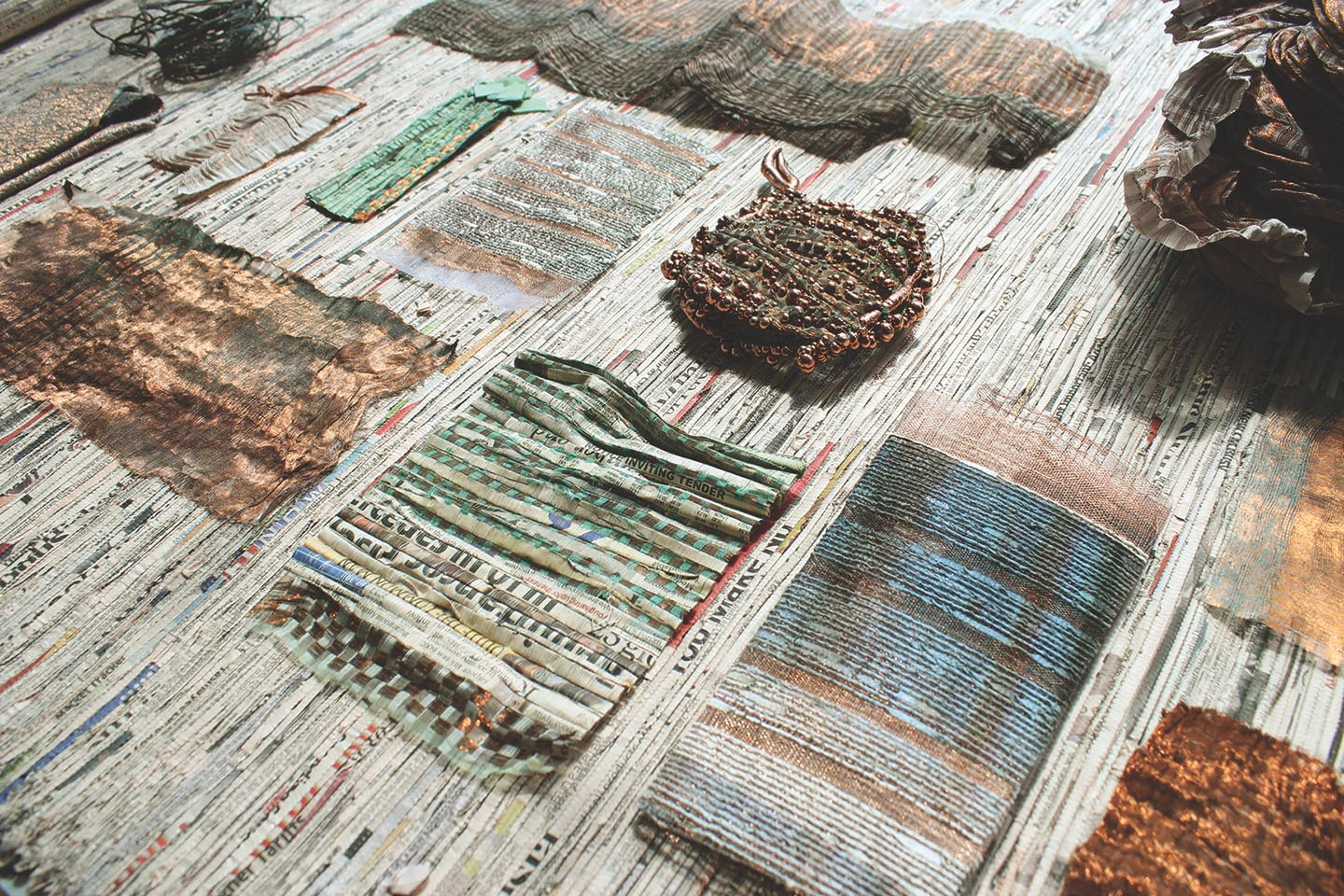 Integrating recycled paper yarn into the weave of copper wire allowed Neha Lad to create a less brittle, and more usable woven material.
