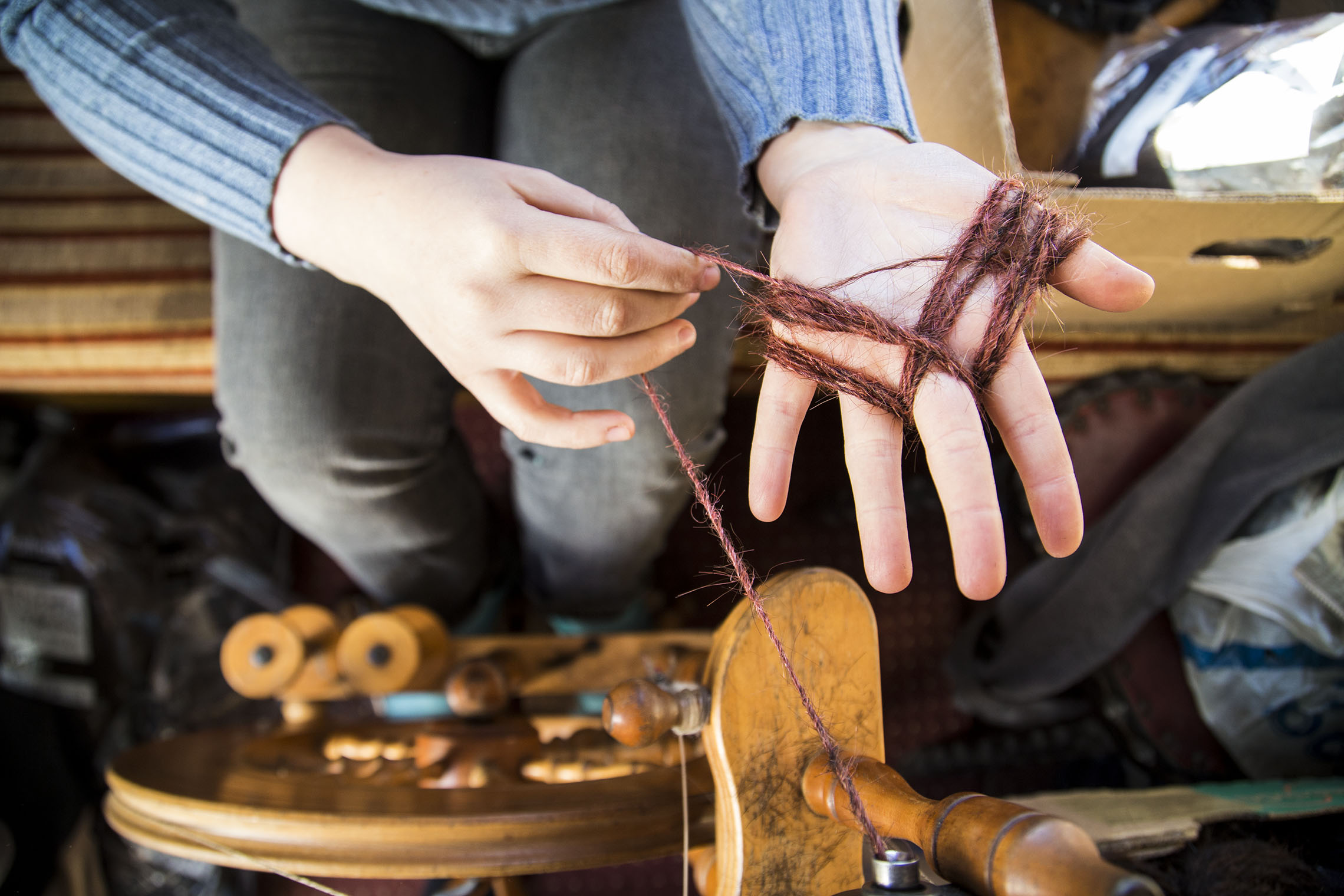 Spinning : The timeless craft process that allowed Sanne Visser to transform human hair waste into usable yarn.