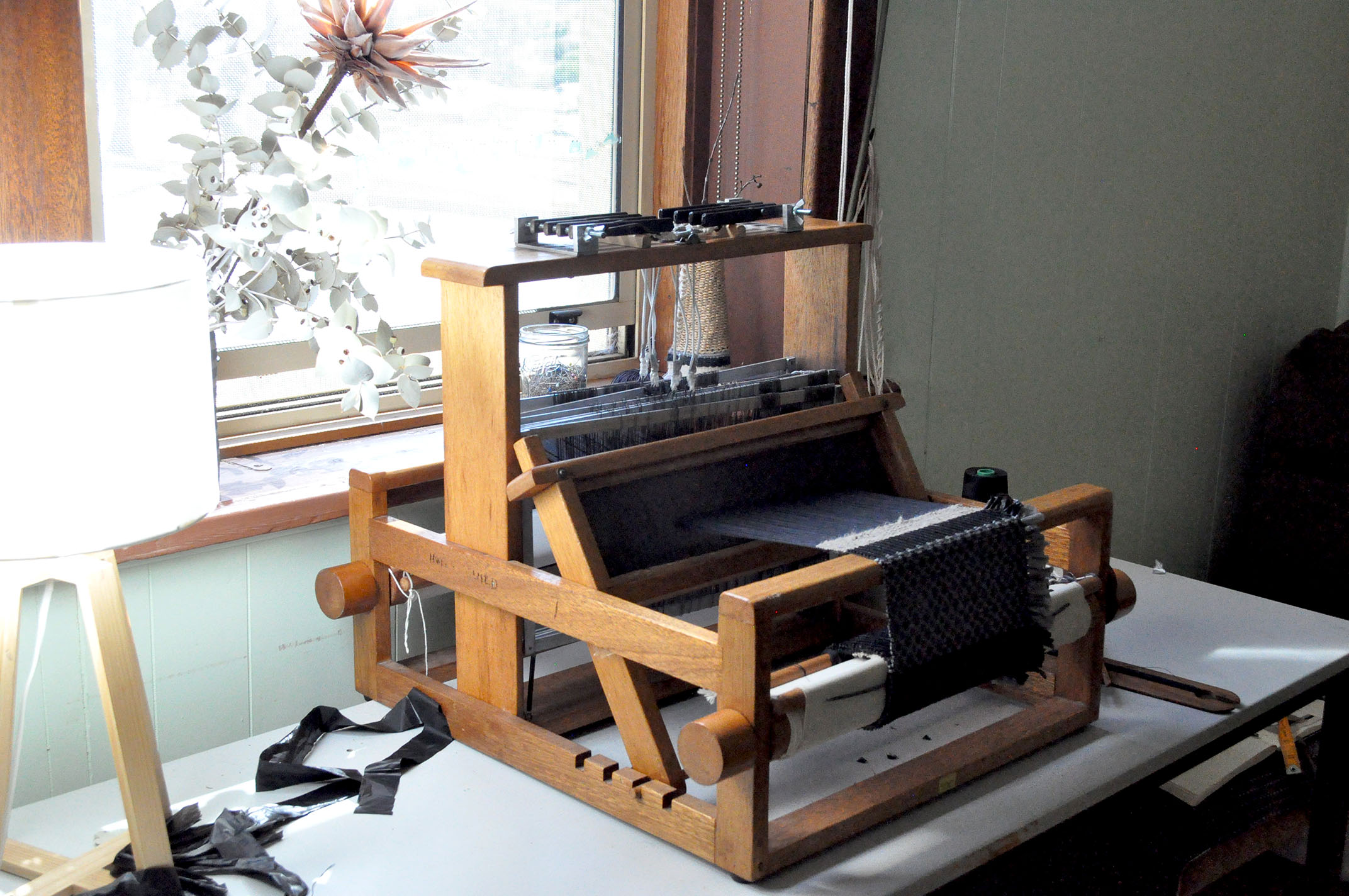 Blake uses this 8 shaft table loom to weave together natural and synthetic materials for his woven creations.
