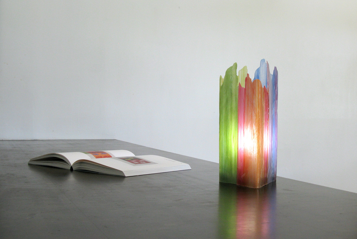 Painterly Spectrum Resin   by Taeg Nishimoto is a table lamp made of epoxy resin cast on the surface of parchment paper, on which color strokes are applied beforehand using latex paint.