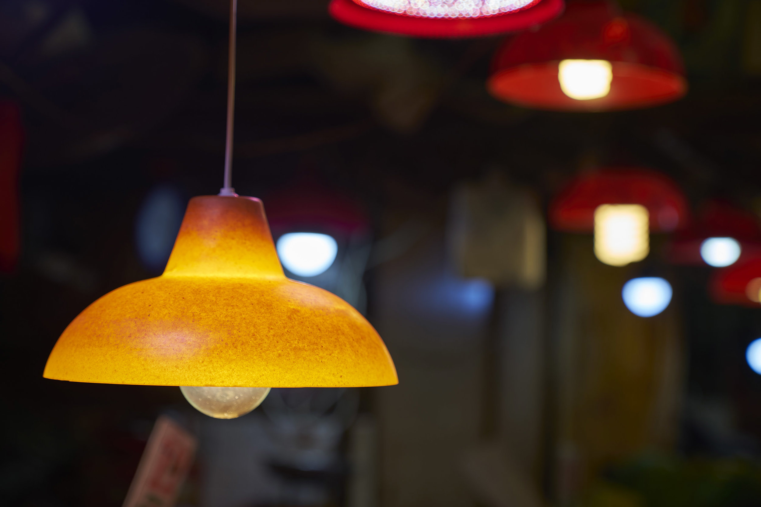 A material sample is molded to the shape of the iconic red Market Lamp, seen in Hong Kong's wet markets.  The Peel Project  by Venn Reactor