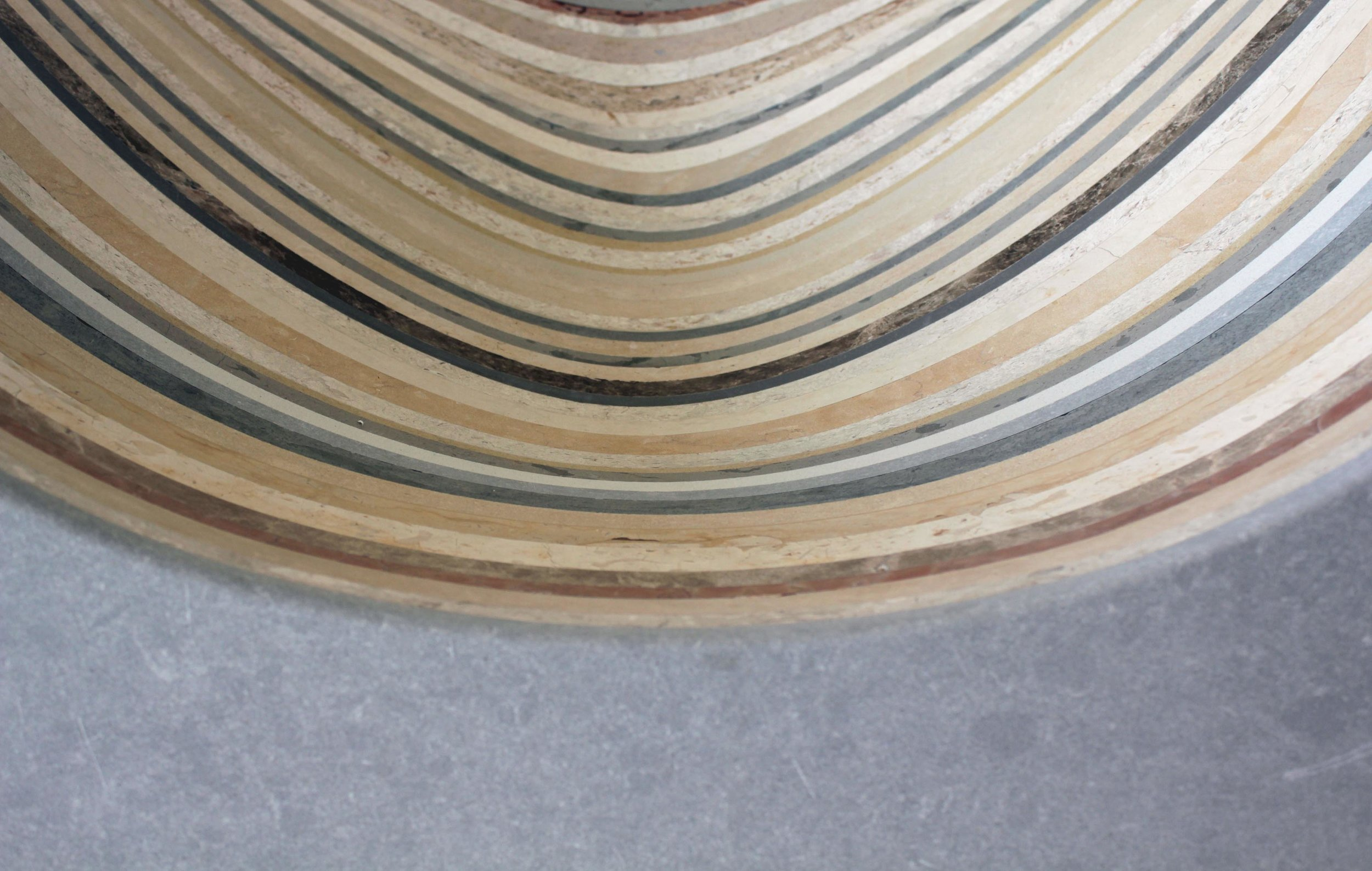The layering of stone surplus, seen in the  Kutleh Chair