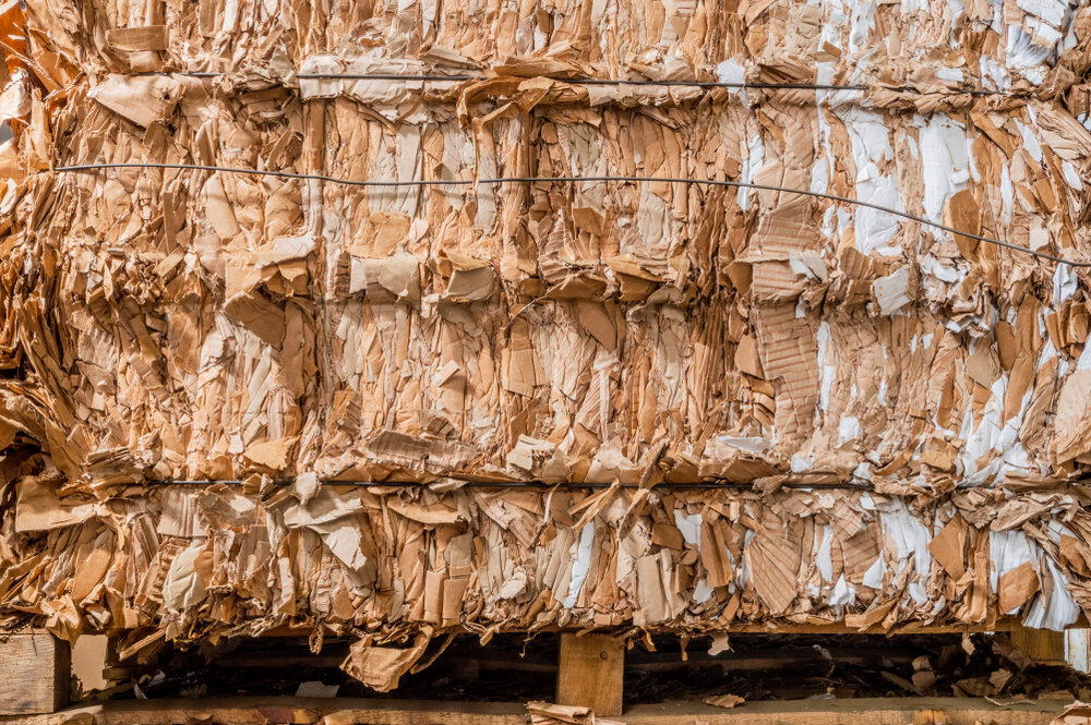 Paper and cardboard waste are among the many waste streams transformed by ECOR into their Fiber Alloys. These include spent brewers' grains, denim lint, textiles, recycled labels, coffee grounds, oat and rice waste and more.