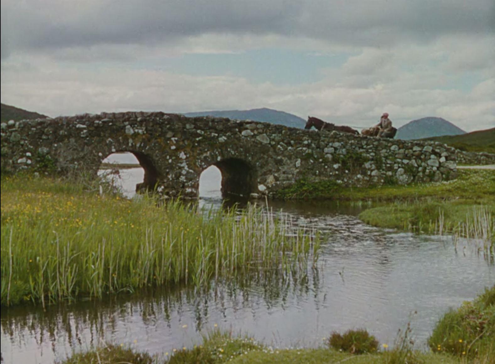 Sean Thornton (John Wayne) crosses the bridge as he enters the town in  The Quiet Man .
