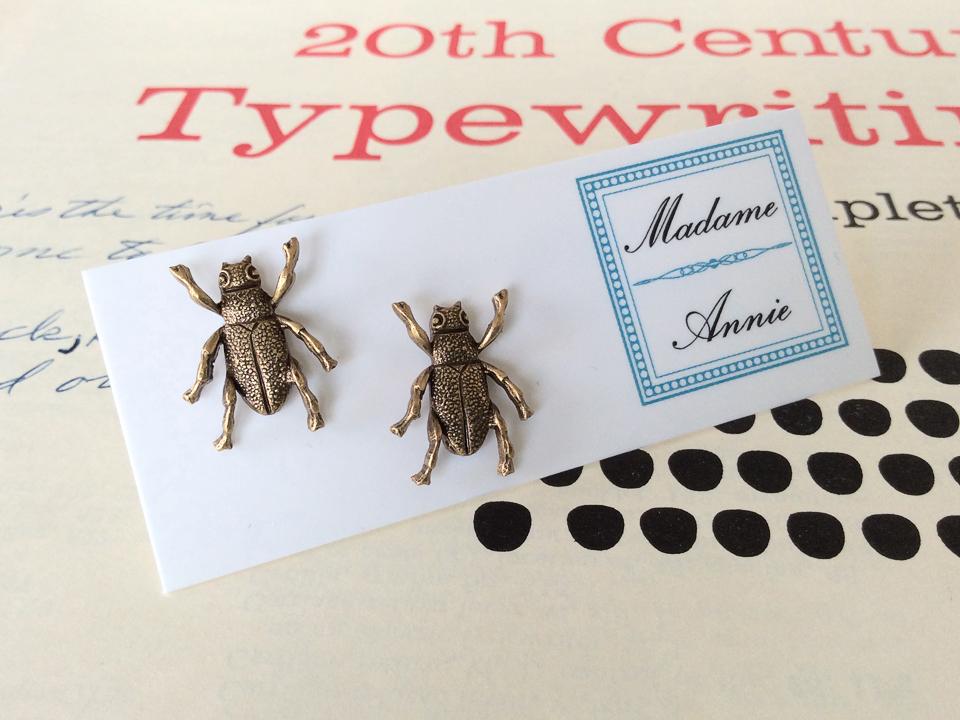 e-stud69-br<br>brass beetles</br>