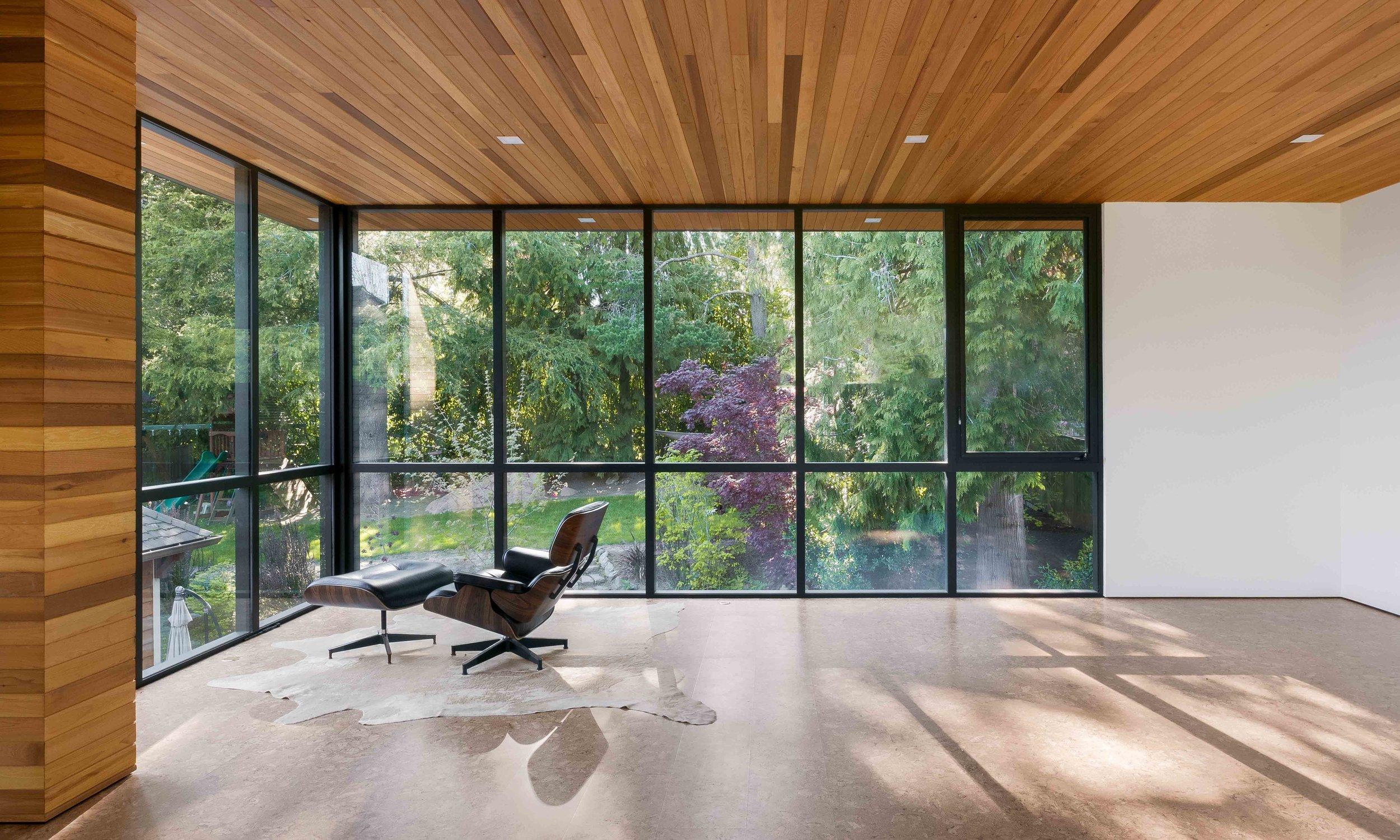 A northwest modern family room that overlooks the backyard garden.