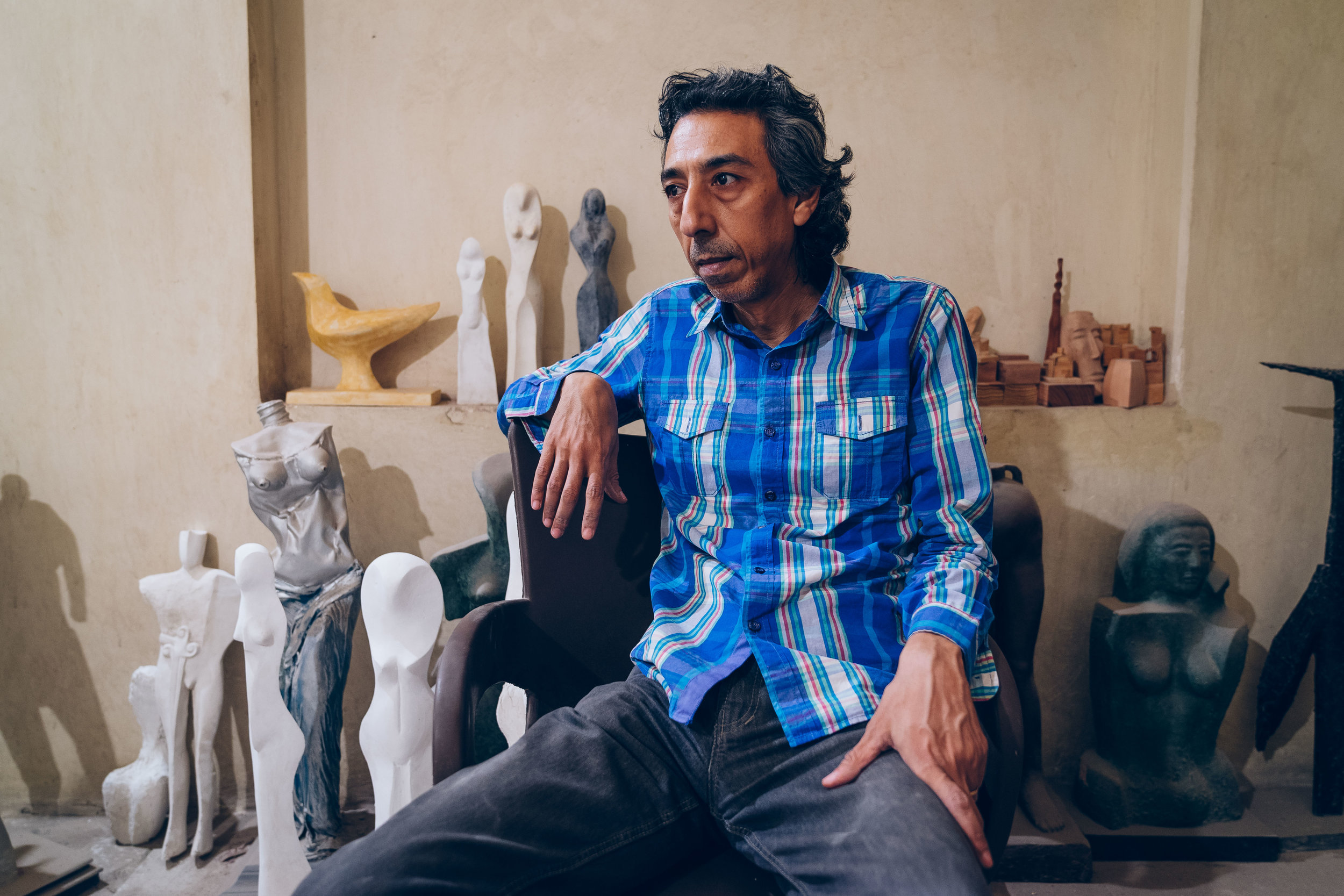 Hesham Nawwar, sculptor and painter, in his studio